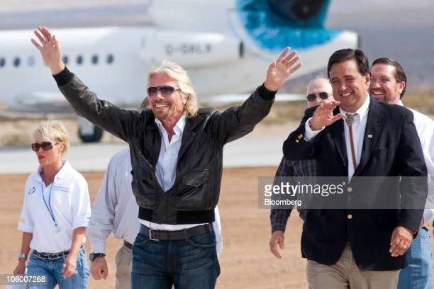 Richard Branson, founder and chairman of Virgin Group Ltd., center, arrives with New Mexico Governor Bill Richardson, right, at an event...