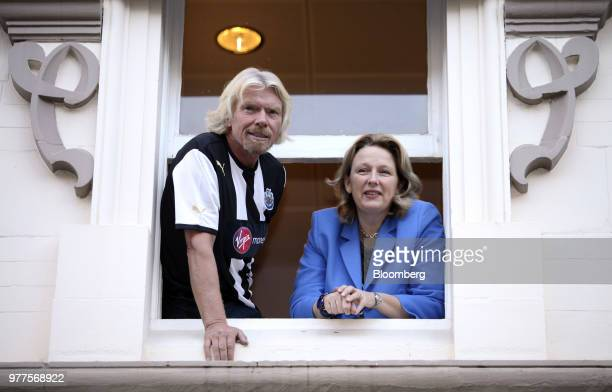 Richard Branson the founder of Virgin Group Ltd left and JayneAnne Gadhia chief executive officer of Virgin Money Holdings UK Ltd look out from the...