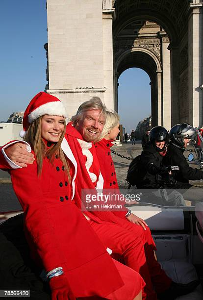 Richard Branson wearing a Santa suit travels in a sports car along the ChampsElysees Avenue past the landmark l' Arc de Triomphe on December 19 2007...