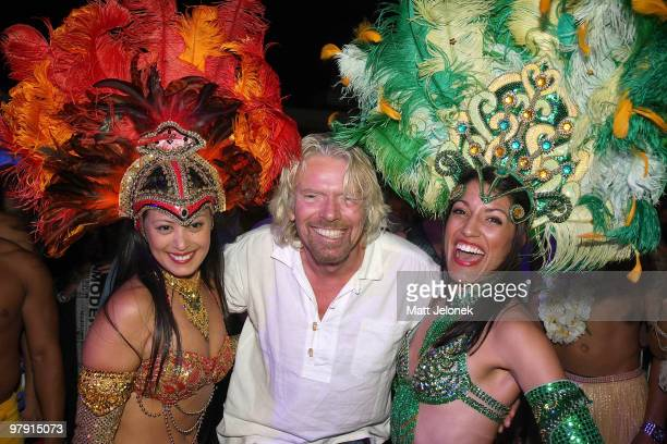 Richard Branson with dancers during the 'Branson By The Pool' function, as part of a series of fundraising events for the Strike A Chord For Cancer...