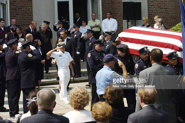 Richard Brooks Jr salutes as the coffin of his father Richard Brooks a retired NYPD lieutenant who was gunned down last week is carried from St...