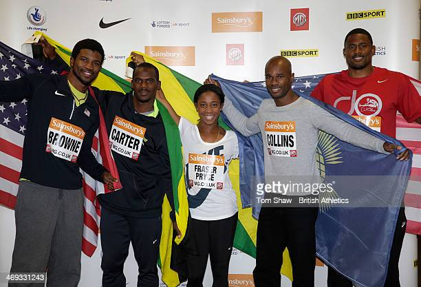 Richard Brown of the USA Nesta Carter of Jamaica ShelleyAnn FraserPryce of Jamaica Kim Collins of St Kitts and Nevis and David Oliver of the USA pose...