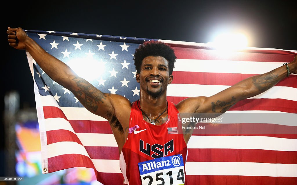 Richard Browne of the United States celebrates setting a new world record and winning the men's 100m T44 final during the Evening Session on Day Eight of the IPC Athletics World Championships at Suhaim Bin Hamad Stadium on October 29, 2015 in Doha, Qatar.