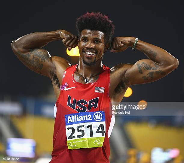 Richard Browne of the United States celebrates setting a new world record and winning the men's 100m T44 final during the Evening Session on Day...