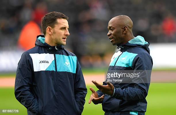 Richard Buchanan Performance director and Claude Makelele speak during the warm up prior to the Premier League match between Swansea City and Arsenal...