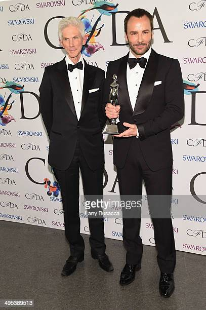 Richard Buckley and Geoffrey Beene lifetime achievement award recipient Tom Ford attend the winners walk during the 2014 CFDA fashion awards at Alice...