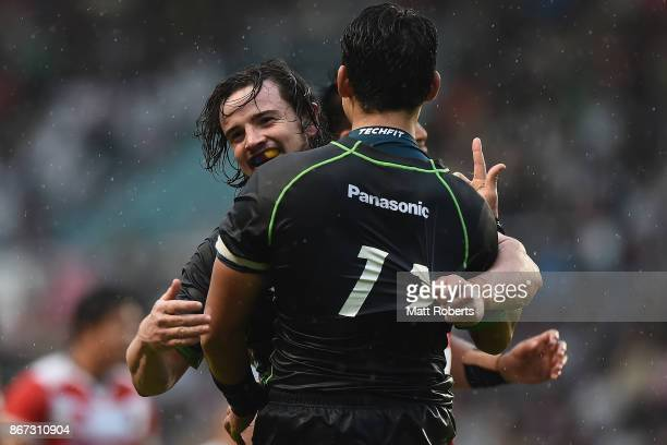 Richard Buckman of World XV celebrates with try scorer Yoshikazu Fujita of World XV during the international match between Japan XV and World XV at...