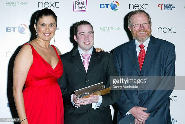 Richard Burbridge aged 27 from Reading with his Living Life award with presenters Amanda Lamb and Bill Bryson during the Breathing Life Awards at the...
