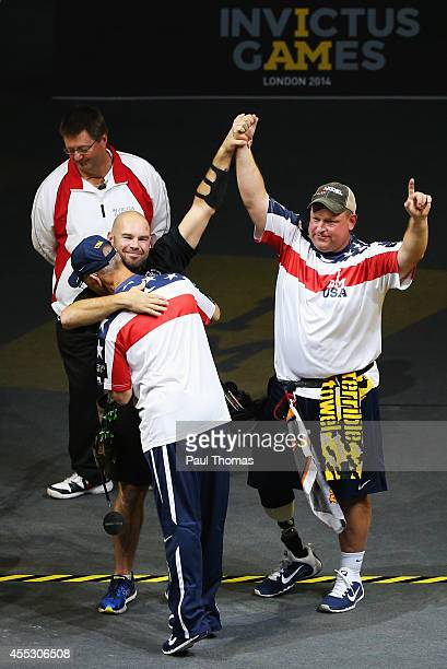 Richard Burkett of the United States celebrates winning the gold medal with silver medalist Luc Martin of Canada in the Mixed Individual Compound...