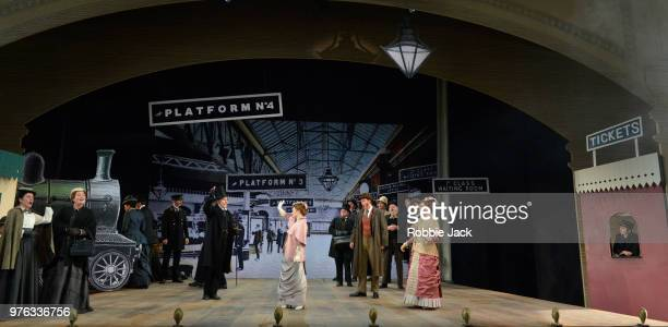 Richard Burkhard as Ford and Soraya Mafi as Nannetta with artists of the company in Giuseppe Verdi's Falstaff directed by Bruno Ravella and conducted...
