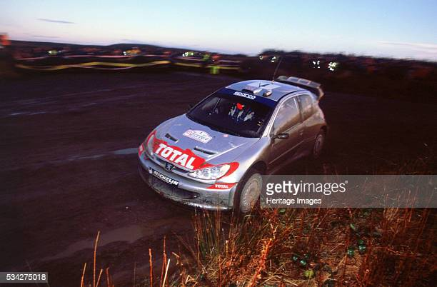 Richard Burns driving Peugeot 206 WRC on 2002 Network Q Rally 2000