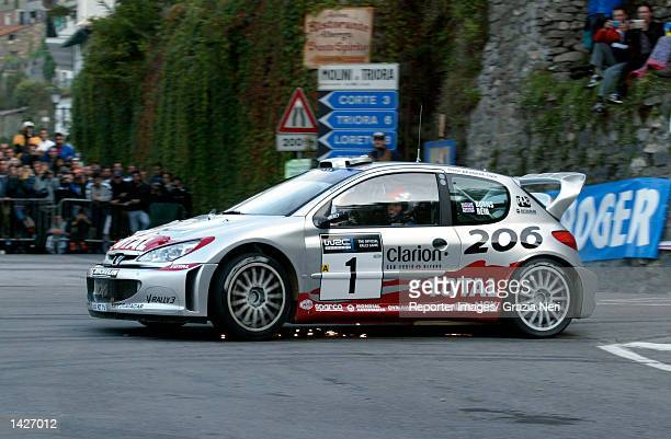 SAN REMO ITALY Richard Burns of Great Britain and the Peugeot 206 WRC team in action during the first stage of the San Remo Rally the eleventh stage...