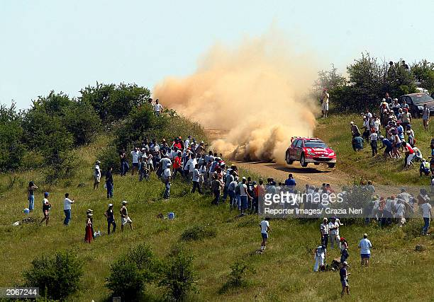 Richard Burns of Great Britain drives his Peugeot 206 WRC during the first stage of the WRC Acropolis Rally on June 8 2003 in Greece