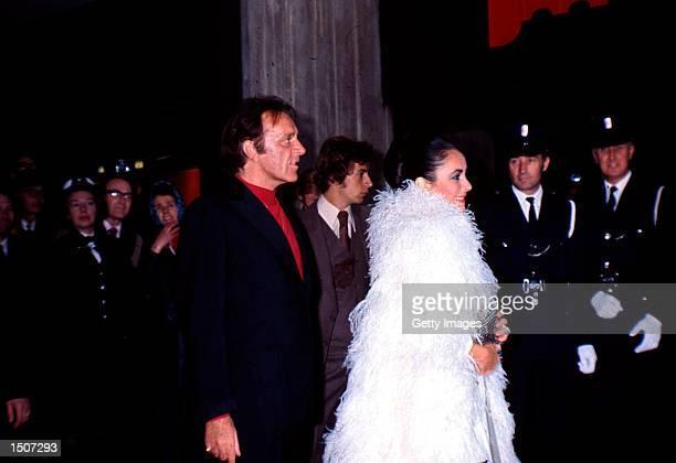 Richard Burton and Elizabeth Taylor in London, England for his 50th Birthday, November 14, 1975.