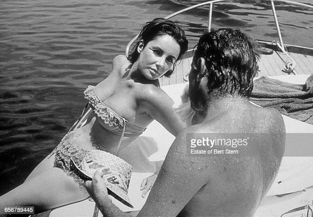 Richard Burton and Elizabeth Taylor on a boat in Ischia Italy during filming for the barge scenes on 'Cleopatra' June 1962