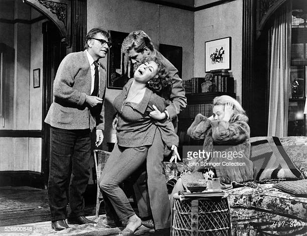 Richard Burton as George Elizabeth Taylor as Martha George Segal as Nick and Sandy Dennis as Honey in the 1966 film Who's Afraid of Virginia Woolf