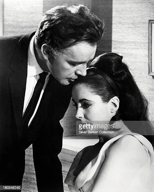 Richard Burton , as Paul Andros, and Elizabeth Taylor , as Frances Andros, in 'The V.I.P.s', directed by Anthony Asquith, 1963.