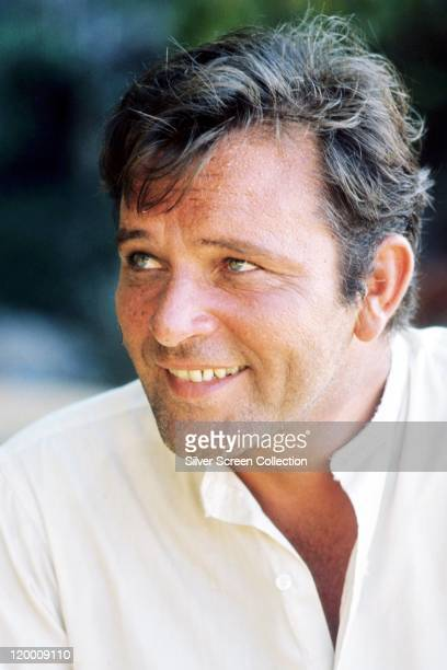 Richard Burton British actor smiling and wearing an opennecked white shirt circa 1965