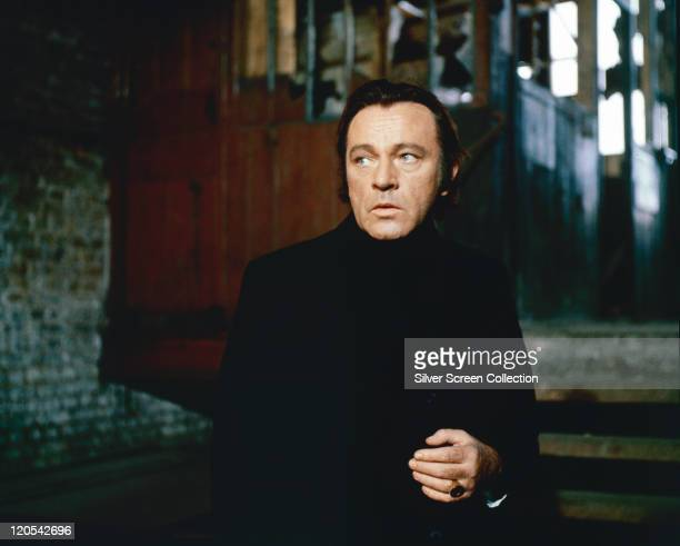 Richard Burton British actor wearing black clothing in a publicity still issued for the film 'Villain' 1971 The gangster film directed by Michael...