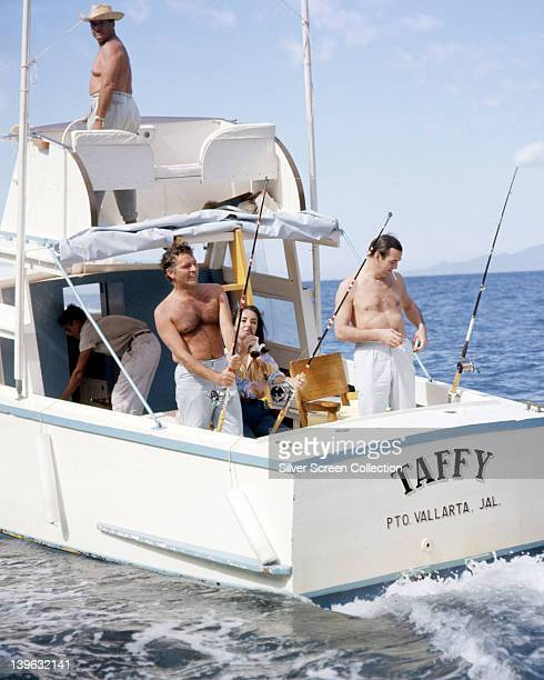 Richard Burton British actor with his wife Elizabeth Taylor and Stanley Baker British actor on a fishing trip in Burton's boat 'Taffy' in the Pacific...