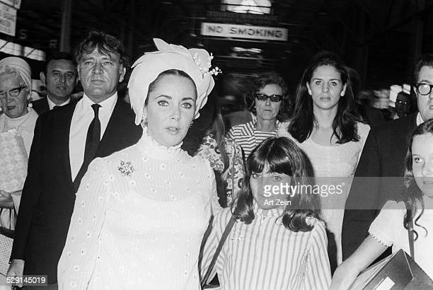 Richard Burton Elizabeth Taylor and Wilding Family leaving the QEII circa 1970 New York