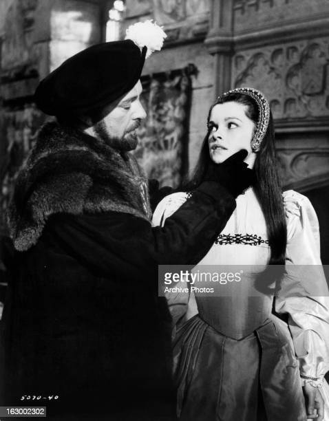 Richard Burton examines Geneviève Bujold in a scene from the film 'Anne Of The Thousand Days' 1969