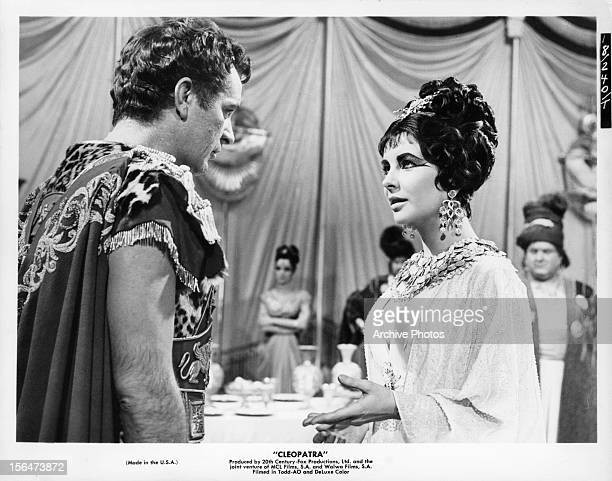 Richard Burton listening to Elizabeth Taylor in a scene from the film 'Cleopatra' 1963