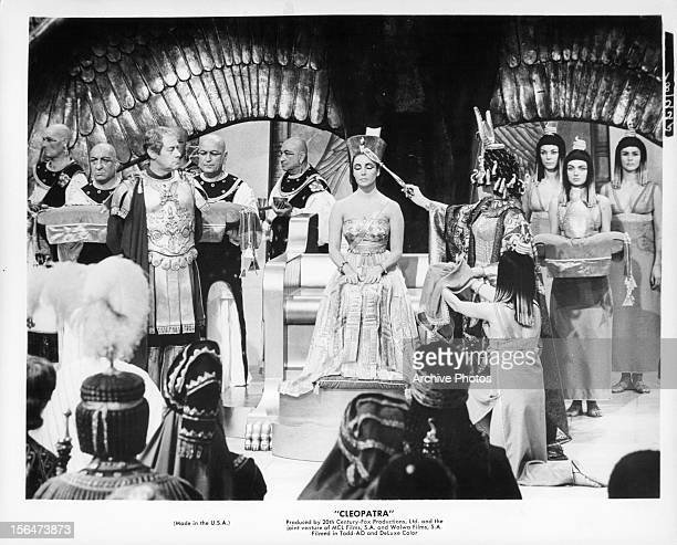 Richard Burton looking over at Elizabeth Taylor in a scene from the film 'Cleopatra' 1963