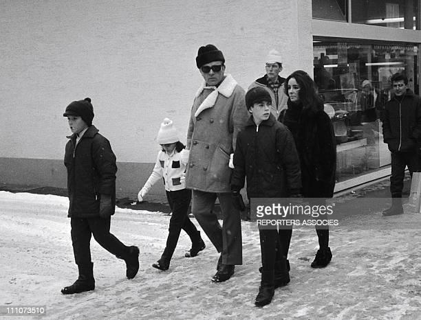 Richard Burton Michael and Christopher Wilding Elisabeth Todd Liz Taylor in Gstaad Switzerland on December 22 1964