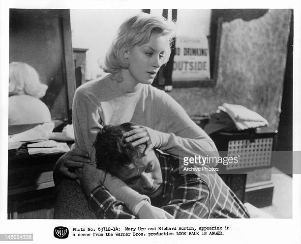 Richard Burton seeking comfort from Mary Ure in a scene from the film 'Look Back In Anger', 1959.