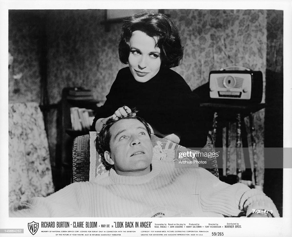 Richard Burton sits back as Claire Bloom plays with his hair in a scene from the film 'Look Back In Anger', 1959.