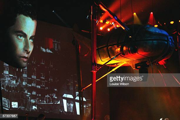 Richard Burton's 'Journalist' voice over is portrayed by an actors image projected onto a giant head setpiece seen with a giant 'Killing Machine'...