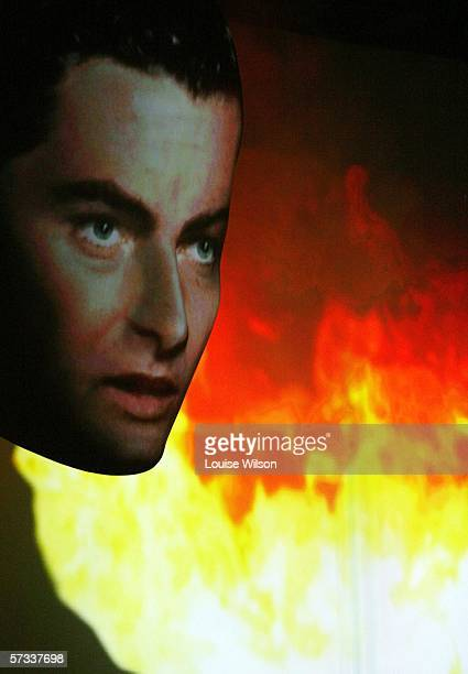 Richard Burton's 'Journalist' voice over is portrayed by an actors image projected onto a giant head setpiece on the opening night of Jeff Wayne's...