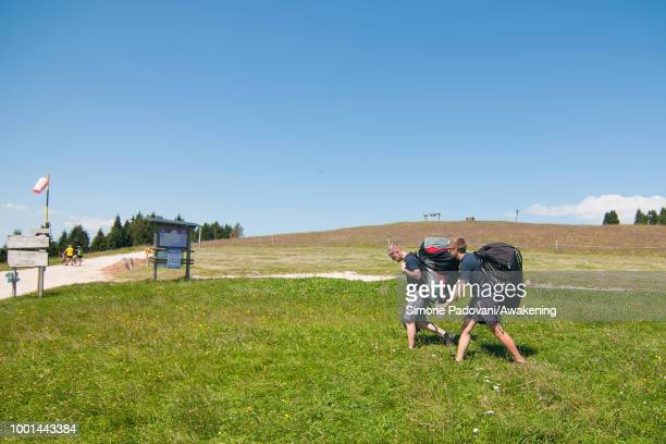 Richard Butterworth and his son arrive at the takeoff area at Monte Avena before the training on July 18 2018 in Feltre Italy Richard Butterworth...
