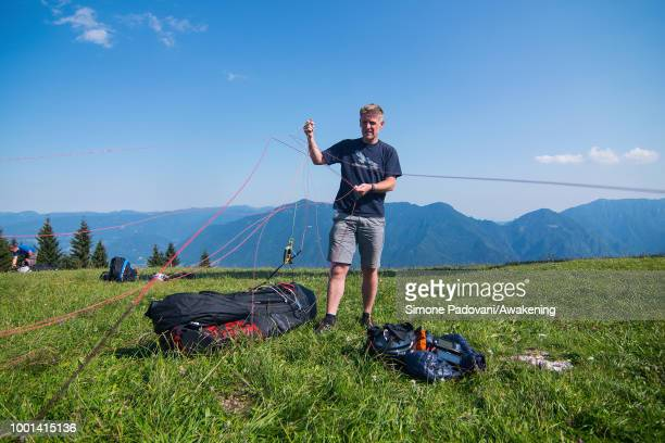 Richard Butterworth checks his paraglider on the takeoff ground before training on July 18 2018 in Feltre Italy Richard Butterworth starts training...