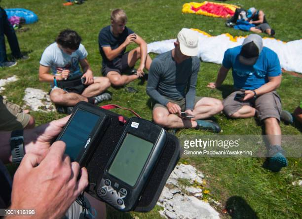 Richard Butterworth checks the settings of the GPS devices with the others British paragliders before the training on July 18 2018 in Feltre Italy...
