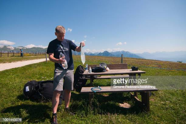 Richard Butterworth fills the water bag for the flight at the takeoff area at Monte Avena before the training on July 18 2018 in Feltre Italy Richard...