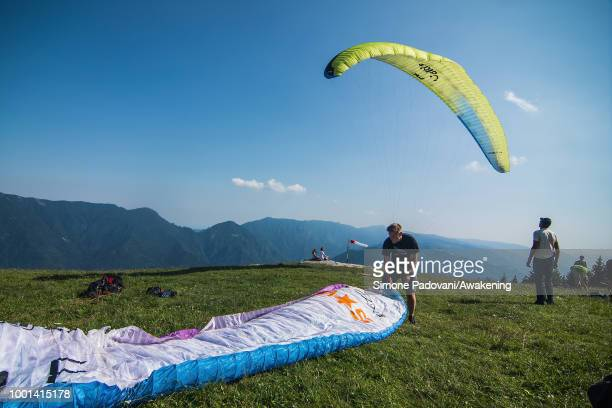 Richard Butterworth prepares his paraglider on the takeoff ground before training on July 18 2018 in Feltre Italy Richard Butterworth starts training...
