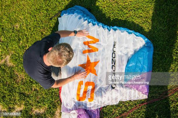 Richard Butterworth sets up his paraglider at the landing Area Boscherai after the training on July 18 2018 in Feltre Italy Richard Butterworth...