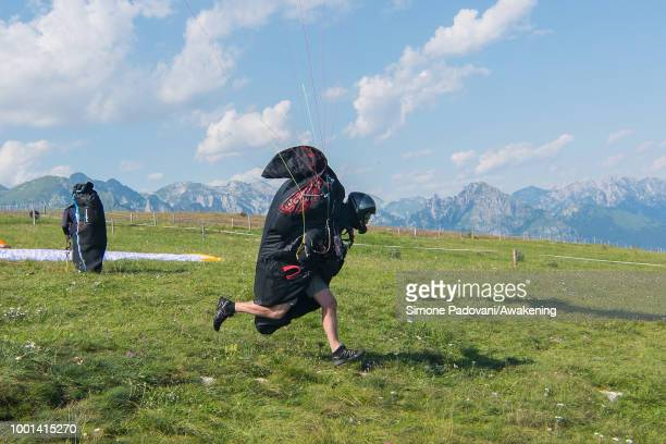 Richard Butterworth starts with his paraglider from the takeoff ground at Monte Avena on July 18 2018 in Feltre Italy Richard Butterworth starts...
