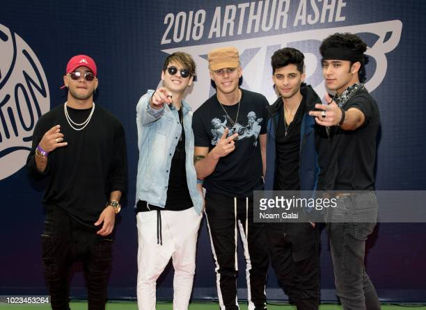 Richard Camacho Zabdiel de Jesus Christopher Velez Erick Brian Colon and Joel Pimentel of CNCO attend the 2018 Arthur Ashe Kids' Day at USTA Billie...