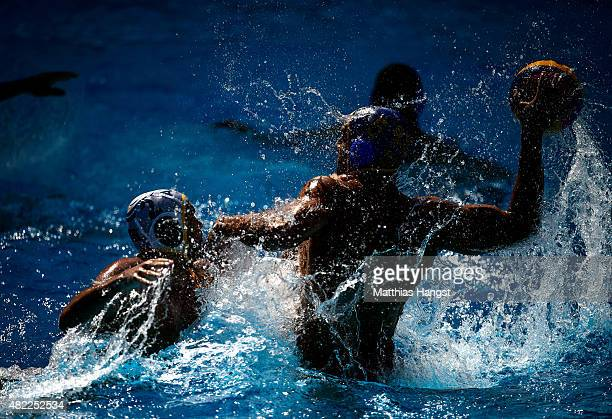 Richard Campbell of Australia challenges Darko Brguljan of Montenegro in the Men's Water Polo Preliminary Round Group D match between Australia and...