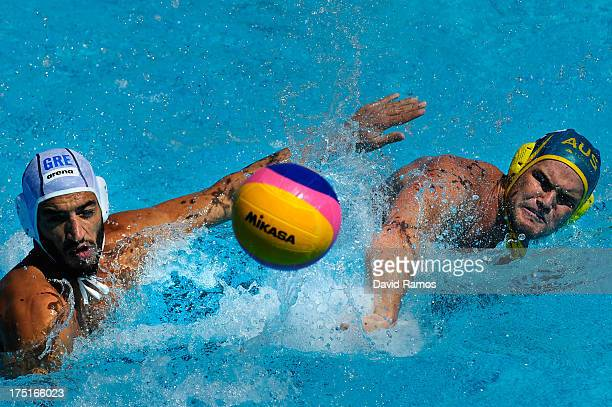 Richard Campbell of Australia in action against Christos Afroudakis of Greece during the Men's Water Polo fifth to eighth place match between Greece...