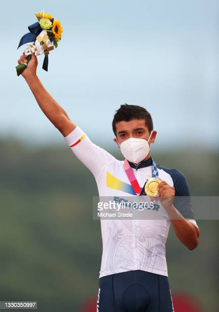 Richard Carapaz of Team Ecuador poses with the gold medal after the Men's road race at the Fuji International Speedway on day one of the Tokyo 2020...