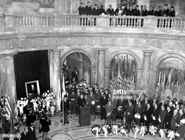 Richard Cardinal Cushing gives the invocation during Kennedy memorial in the Hall of Flags at the Mass State House in Boston Nov 21 1965