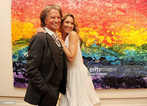Richard Caring and artist Stasha Palos attend a private viewing of 'Colour: An Exhibition By Stasha', featuring works by Stasha Palos, at The Gallery...