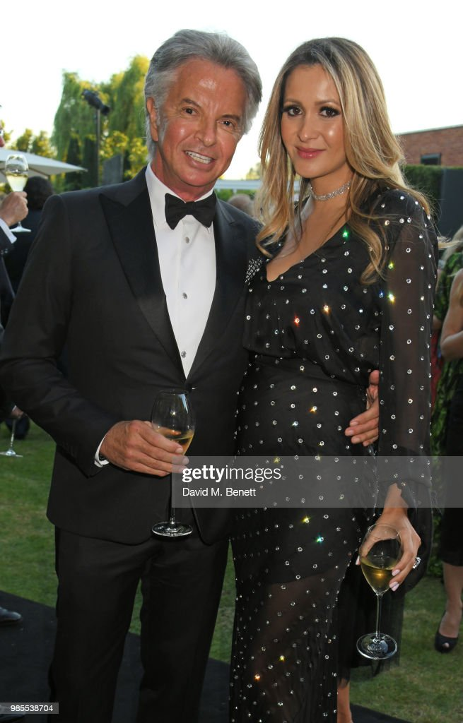 Richard Caring (L) and Patricia Mondinni attend the Argento Ball for the Elton John AIDS Foundation in association with BVLGARI & Bob and Tamar Manoukian on June 27, 2018 in Windsor, England.