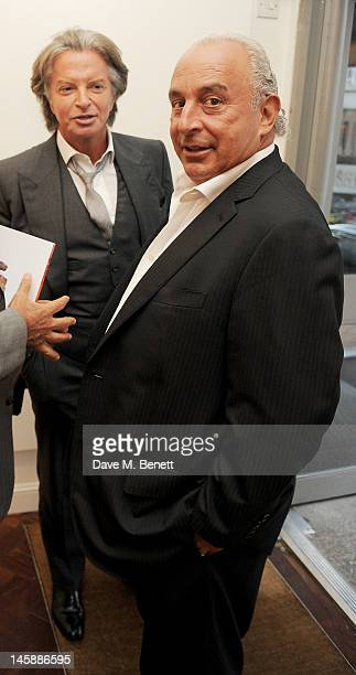 Richard Caring and Sir Philip Green attend a private viewing of 'Colour: An Exhibition By Stasha', featuring works by Stasha Palos, at The Gallery In...