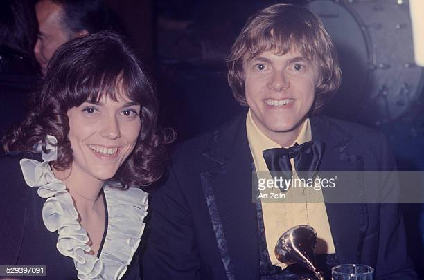 Richard Carpenter with his sister Karen Carpenter holding a Grammy Award circa 1970 New York