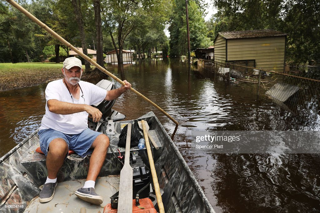 Richard Carter steers a boat through downtown Hartburg as Texas slowly moves toward recovery from the devastation of Hurricane Harvey on September 5, 2017 in Hartburg, Texas. Almost a week after Hurricane Harvey ravaged parts of the state, some neighborhoods still remained flooded and without electricity. While downtown Houston is returning to business, thousands continue to live in shelters, hotels and other accommodations as they contemplate their future.